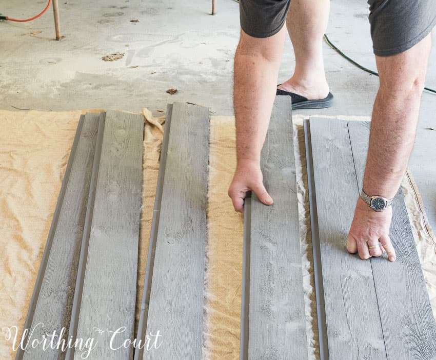 Laying out the wood for a diy barn door.