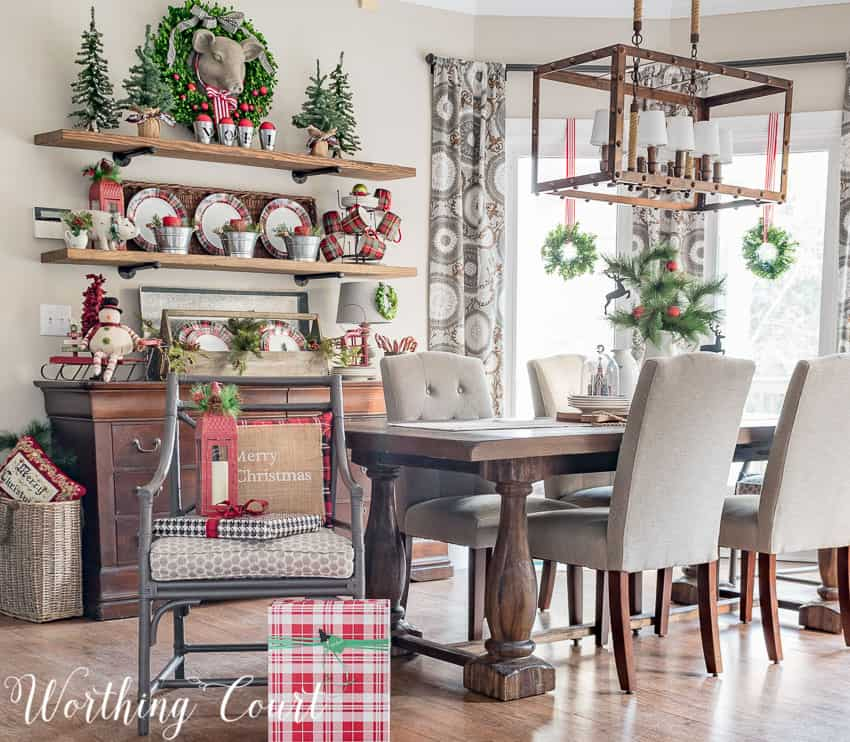 Rustic farmhouse Christmas breakfast nook with open shelving behind the table.