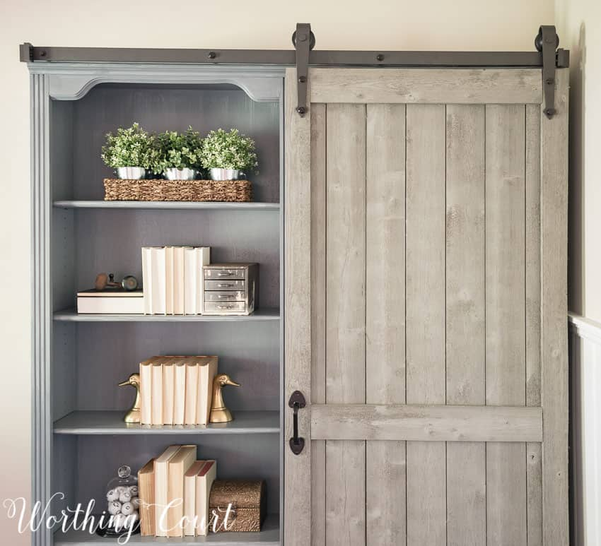 Bookcase makeover traditional cherry to farmhouse fab for Narrow barn door