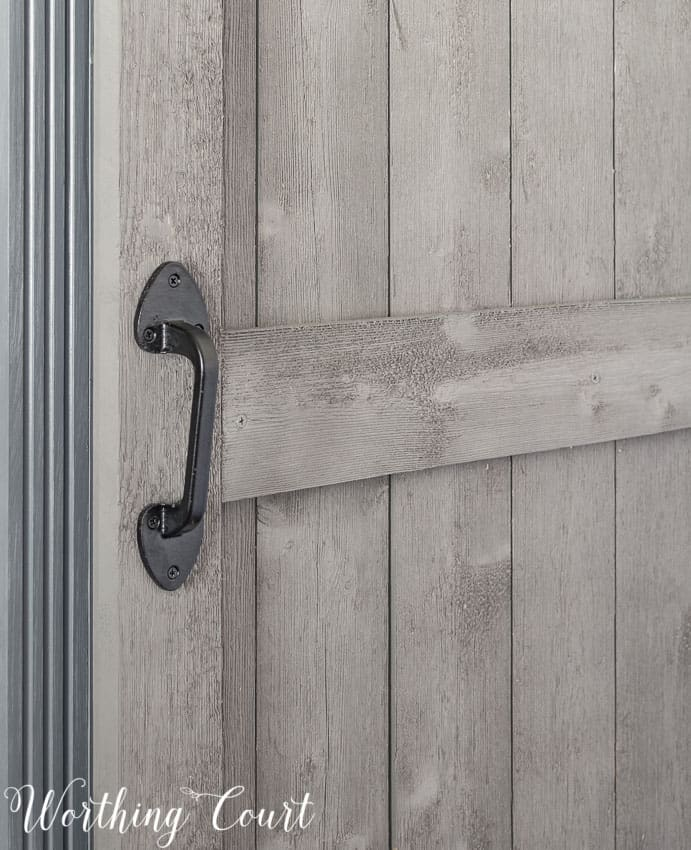 Wrought iron gate handle used on diy sliding barn door