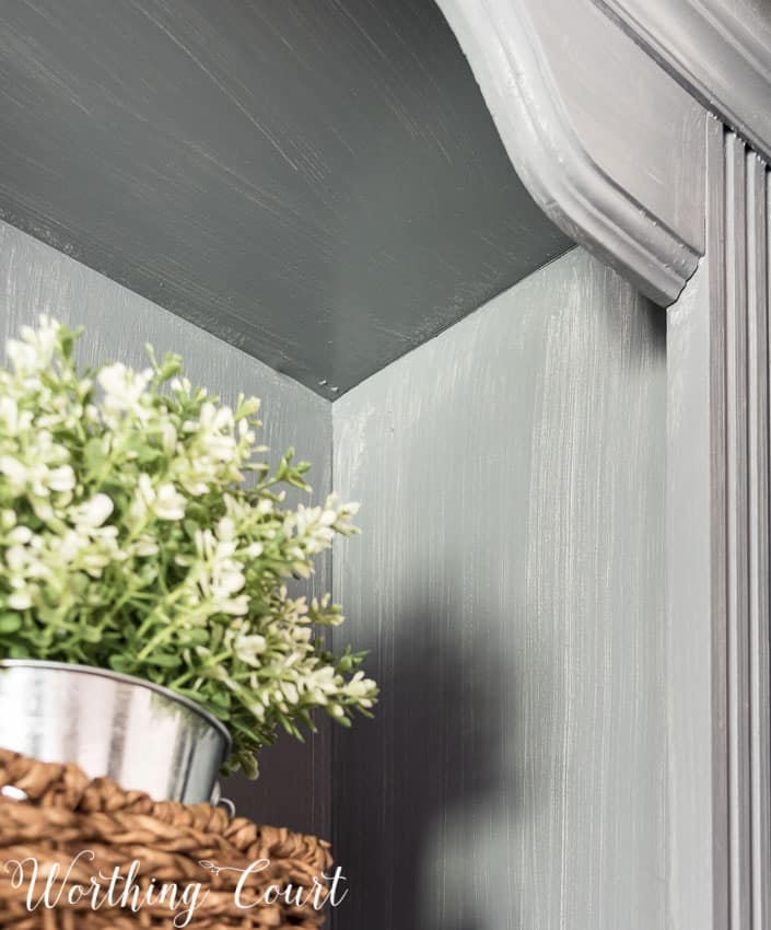 Weathered wood look finish using gray stain on top of gray painted wood.