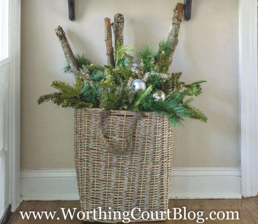 Fill a large basket with an assortment of Christmas greenery, a few sparkly picks, a few shiny ornaments and sticks from your own yard || Worthing Court