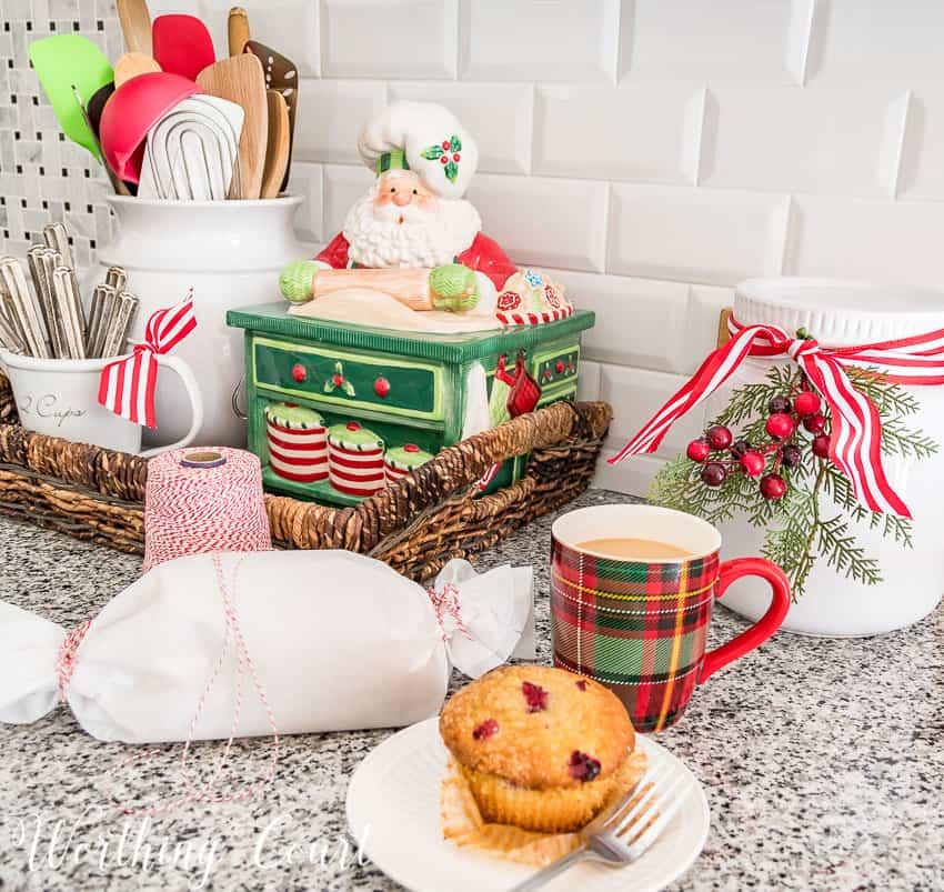 Vintage Fitz and Floyd Christmas cookie jar and a plaid Christmas mug