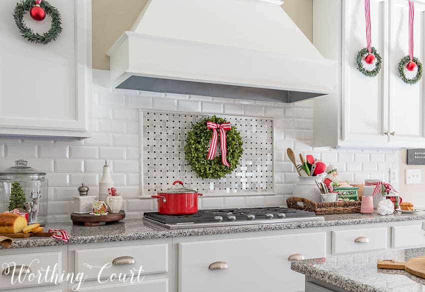 Christmas wreath with red and white striped ribbon above the cooktop || Worthing Court