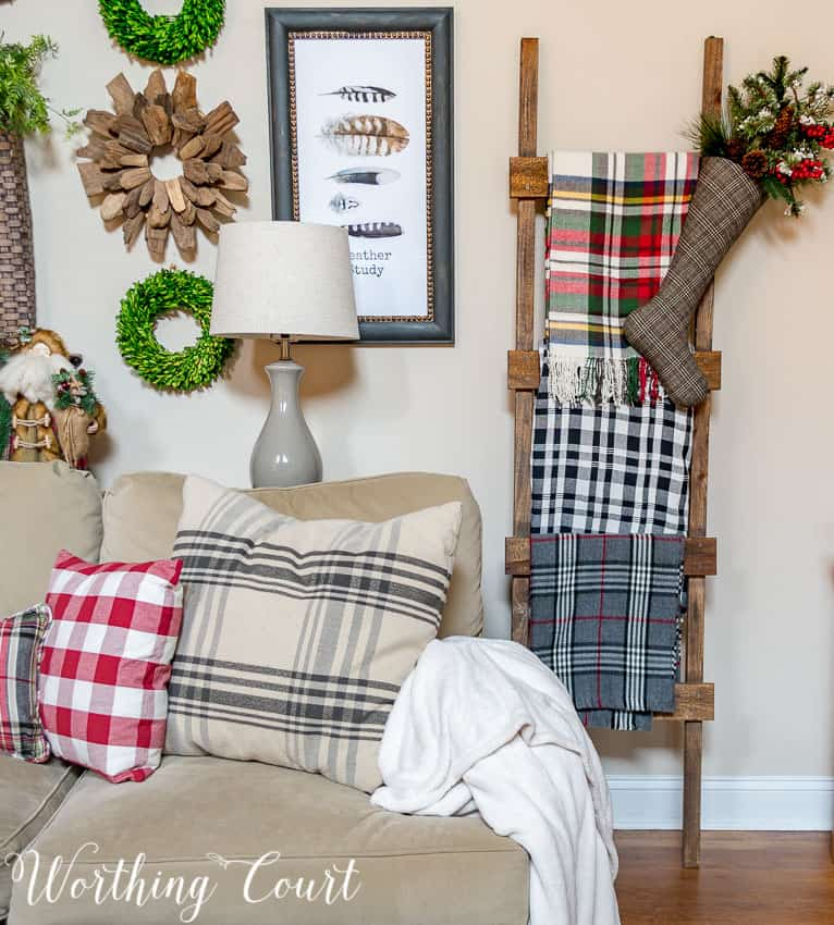 DIY rustic farmhouse ladder with Christmas throws and blankets || Worthing Court