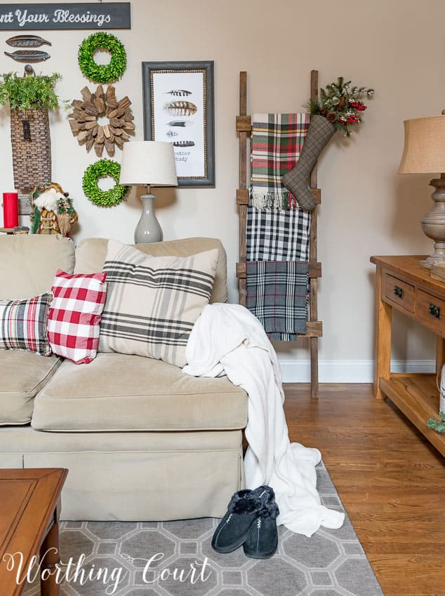 DIY rustic ladder with a variety of plaid Christmas throws || Worthing Court