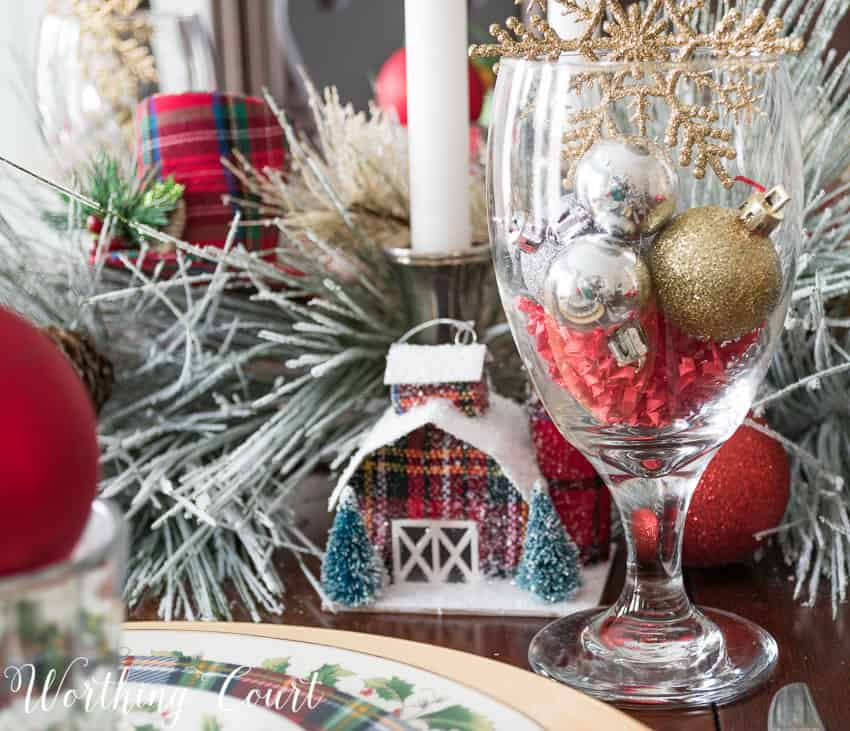 Use Christmas tree ornaments as part of a table centerpiece || Worthing Court