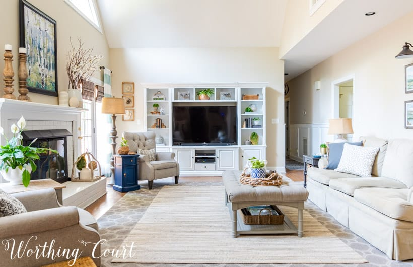 family room with white entertainment center and neutral furniture