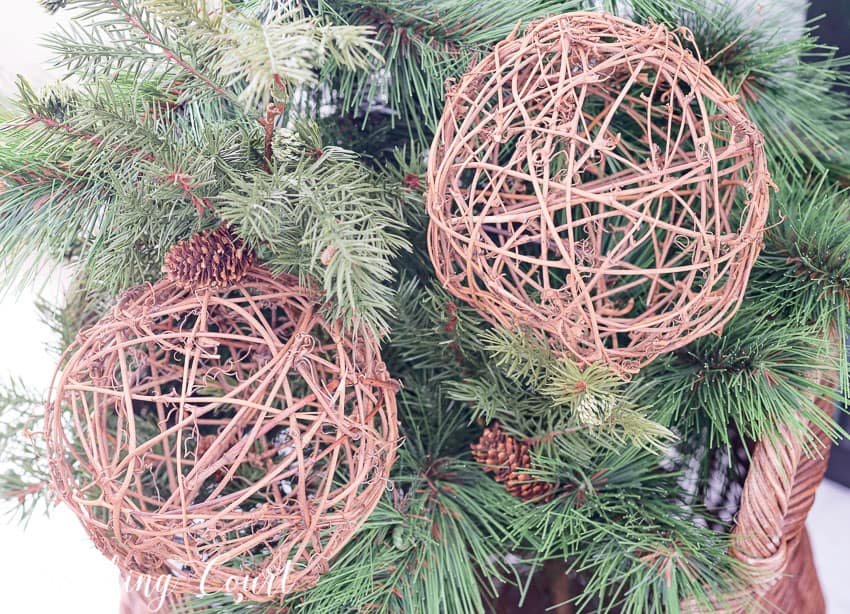 Artificial greenery and grapevine orbs mixed together in a basket for winter || Worthing Court