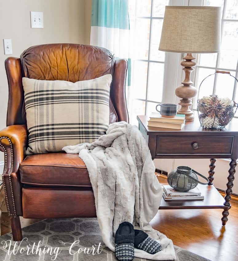 Create a cozy winter corner with a faux fur throw, a patterned pillow and fuzzy slippers || Worthing Court