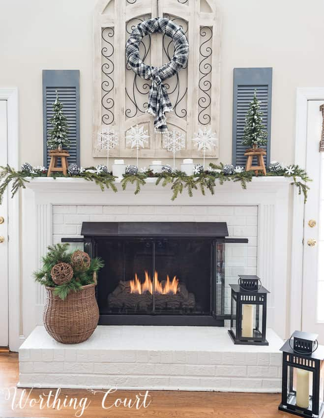 Painted red brick fireplace with winter decor || Worthing Court