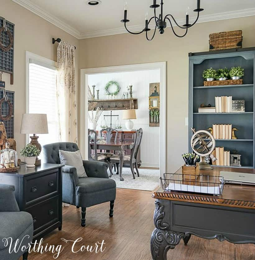 home office with gray chairs, gray bookcases and desk
