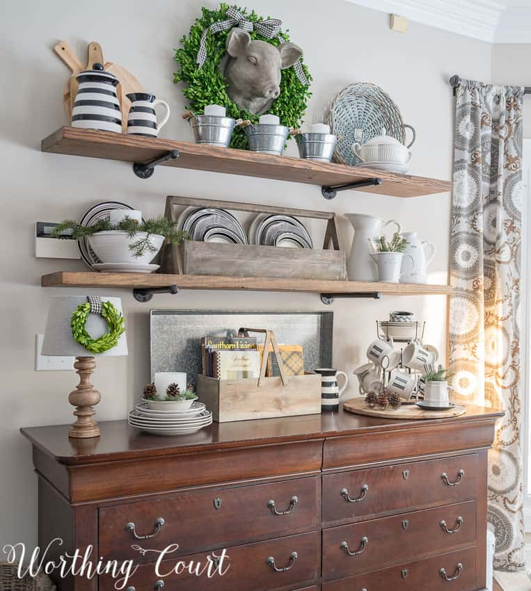 Open rustic industrial shelves with winter decor