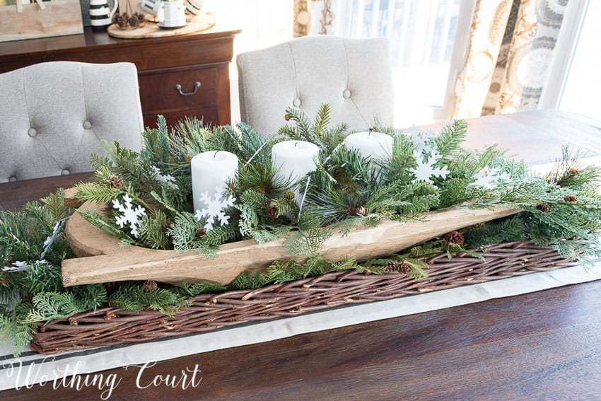 Simple and fast farmhouse winter centerpiece using a dough bowl, white candles and faux Christmas greenery || Worthing Court
