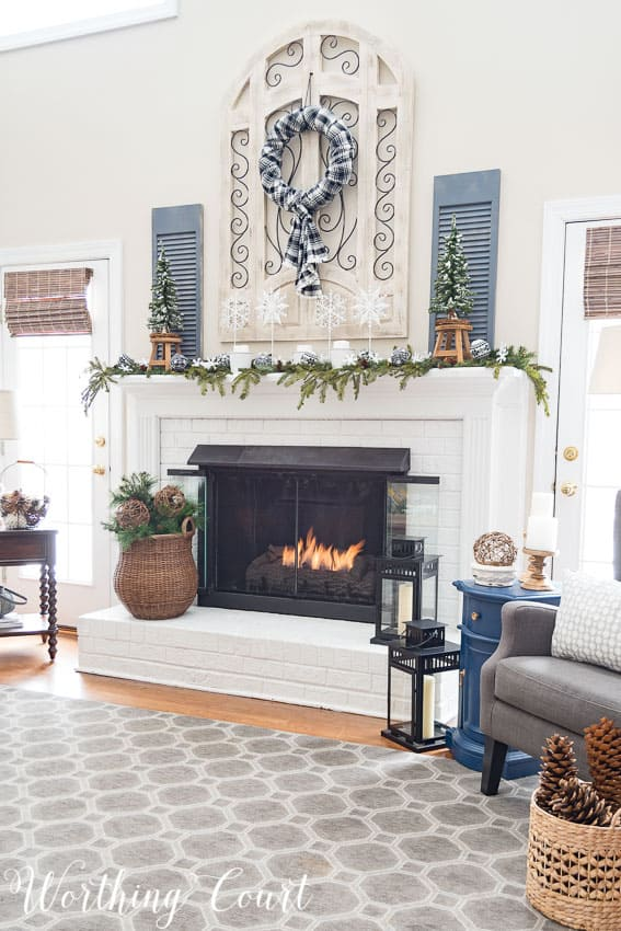 I made sure to use lots of texture and all of the elements of winter when decorating my fireplace. || Worthing Court
