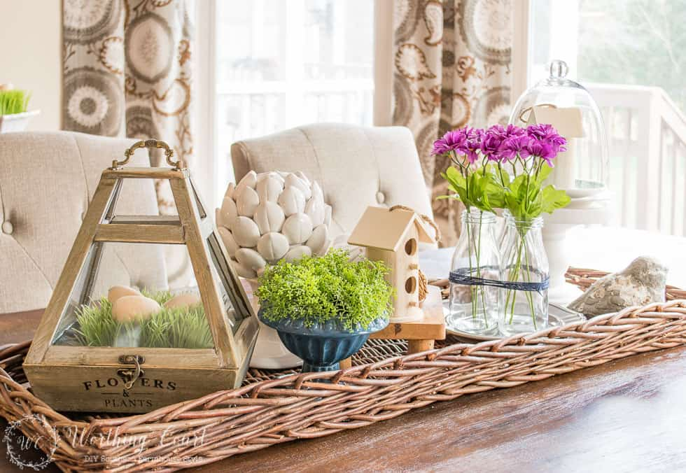 Layering is for horizontal spots too. Put a tray under any grouping to give it importance. #springdecor #centerpiece