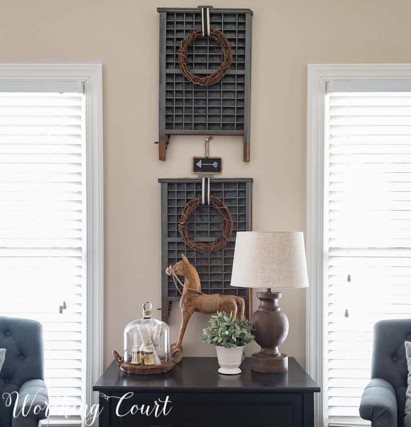 "An easy way to layer - hang a wreath on the front of ""art"" 