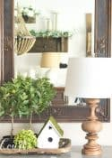 spring vignette with greenery and a birdhouse