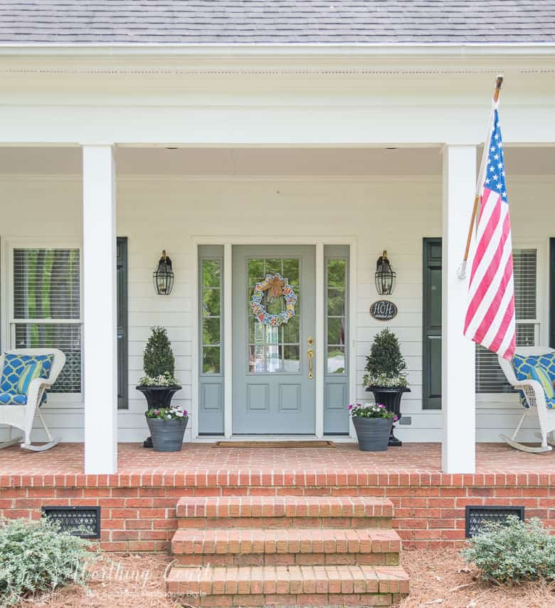 Spring front porch on a traditional brick suburban home || Worthing Court