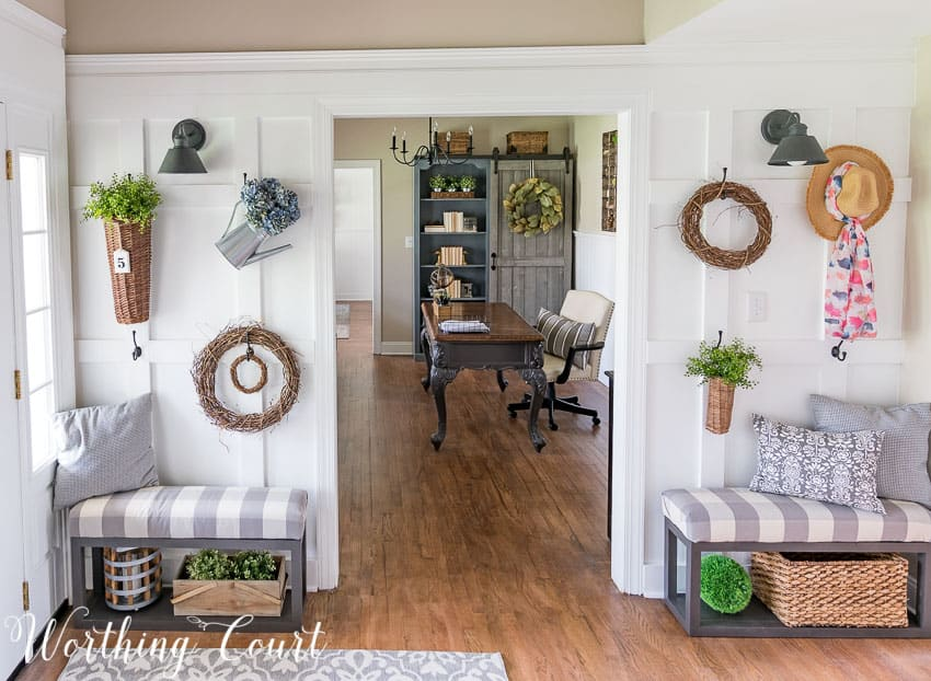 Fill a board and batten wall with baskets, grapevine wreaths and greenery to create a farmhouse feel || Worthing Court