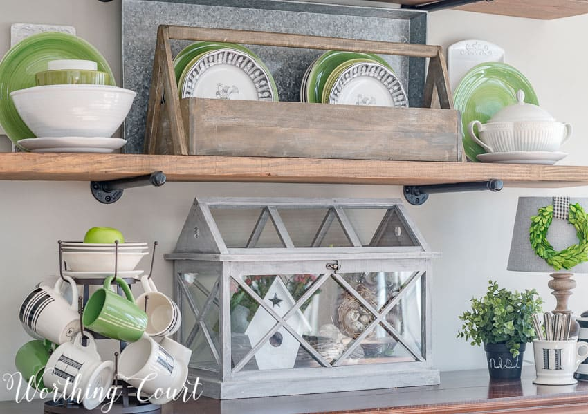 Rustic industrial farmhouse shelves decorated for spring with black, white and green || Worthing Court