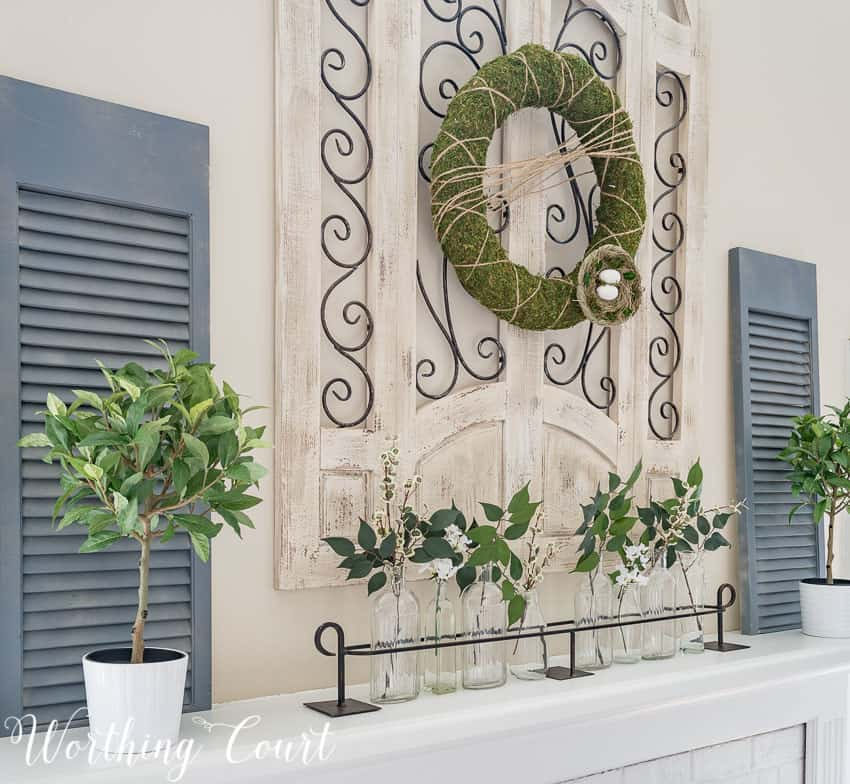 Simple faux greenery in glass bottles make easy spring decor    Worthing Court