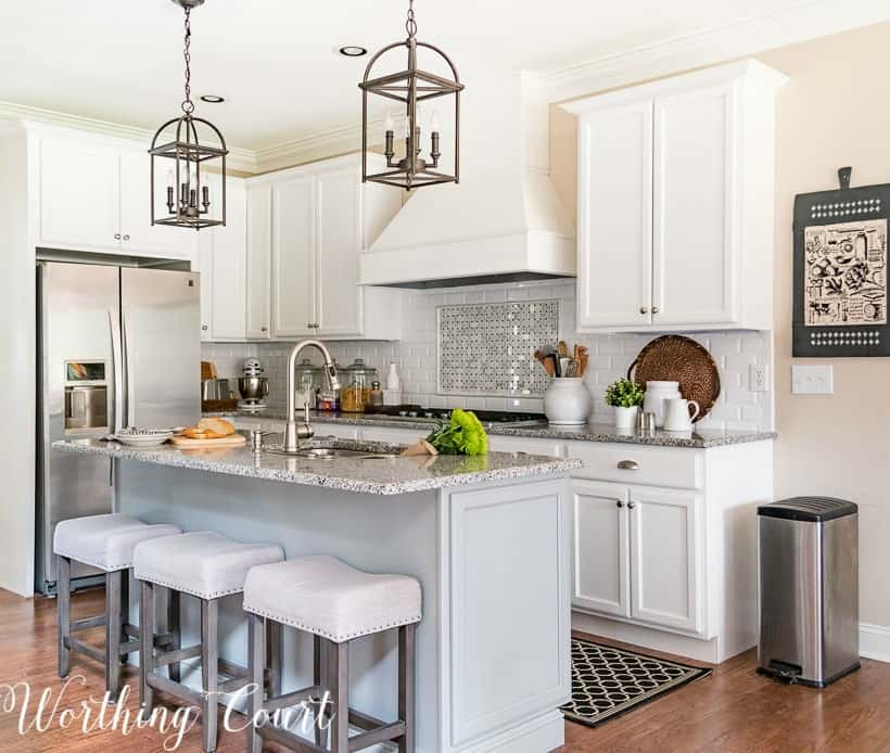 Kitchen with white shaker cabinets and gray island