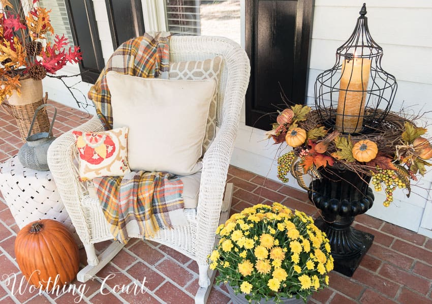 fall porch decorations with a rocking chair and decorated urn