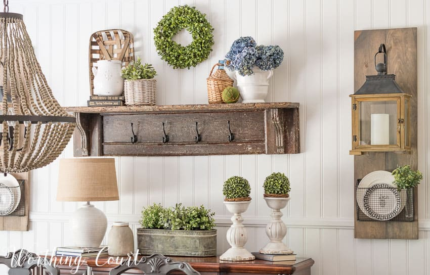 dining room with a planked wall, diy hanging lanterns and a vintage mantel turned into a display shelf