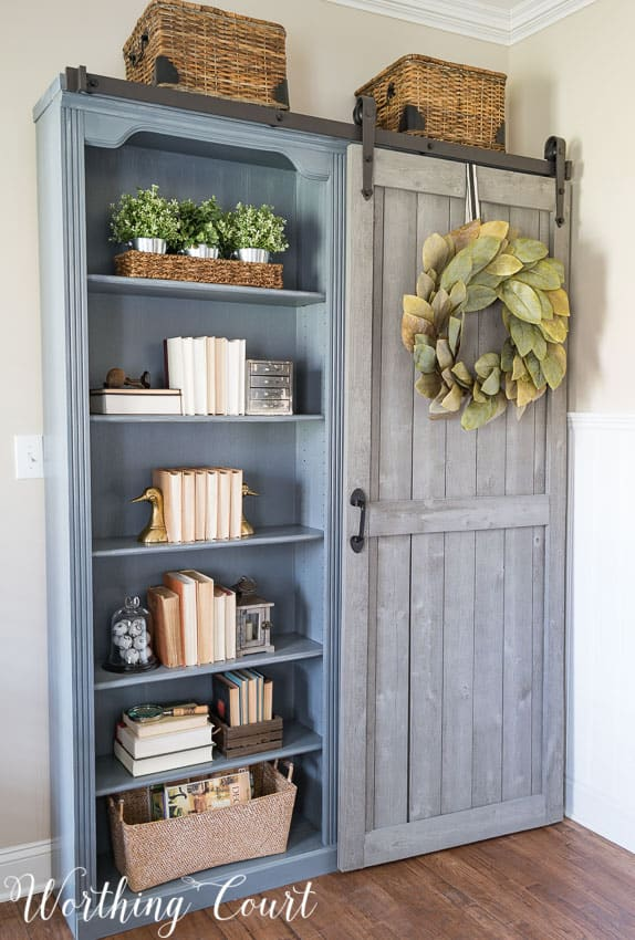 gray bookcases with sliding barn door
