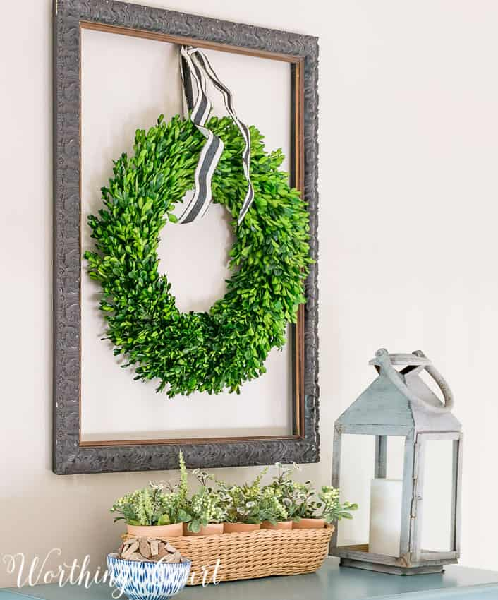 Hang a boxwood wreath inside an old empty picture frame || Worthing Court