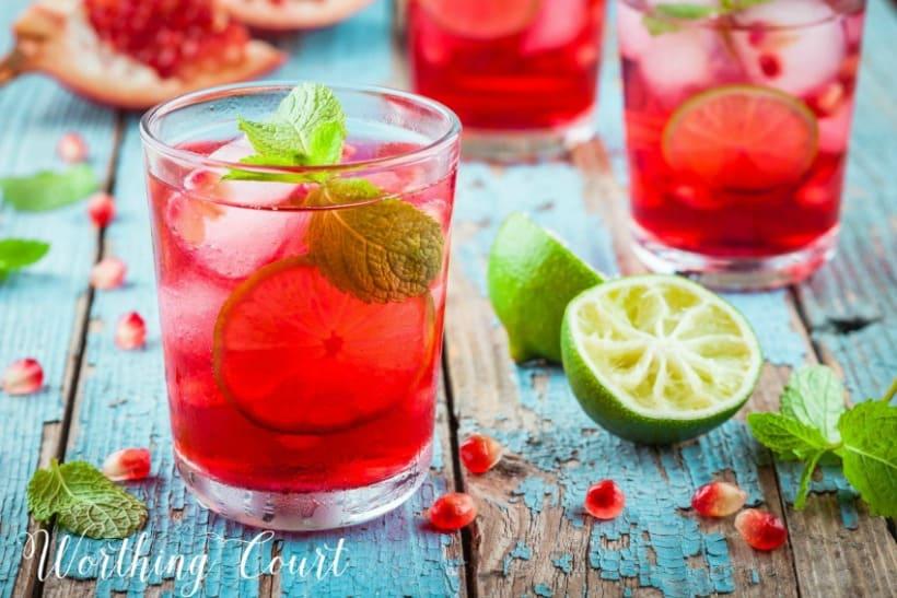 Glass of pomegranate lemonade and mint leaves.