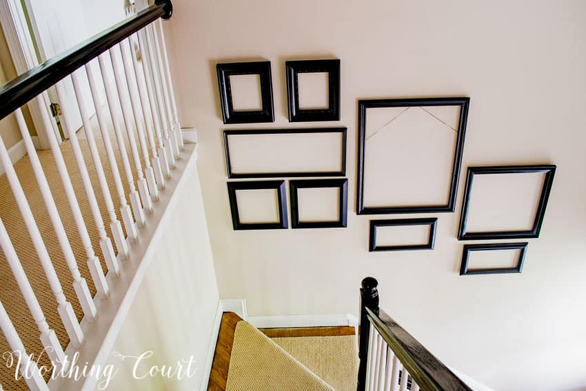 Two story stairway gallery wall frame arrangement || Worthing Court