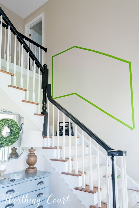 Use painter's tape to help determine the size and layout of a stairway gallery wall || Worthing Court