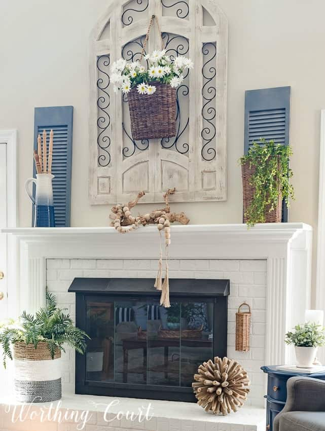 Painted brick fireplace decorated for summer || Worthing Court