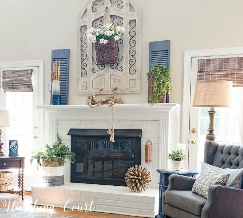 Farmhouse style painted brick fireplace decorated with simple and organic elements for the summer || Worthing Court