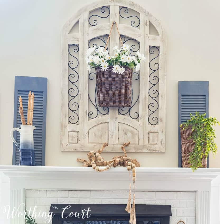 A farmhouse style mantel decorated with simple natural elements for the summer || Worthing Court