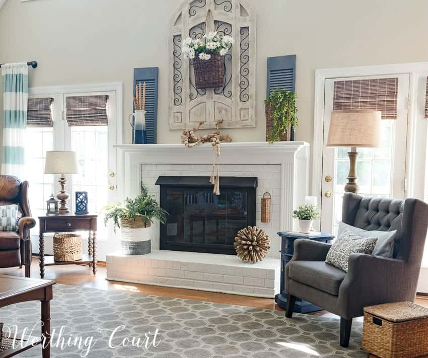 Farmhouse style painted brick fireplace decorated for summer || Worthing Court