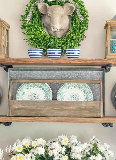 open shelves with blue and green summer decor
