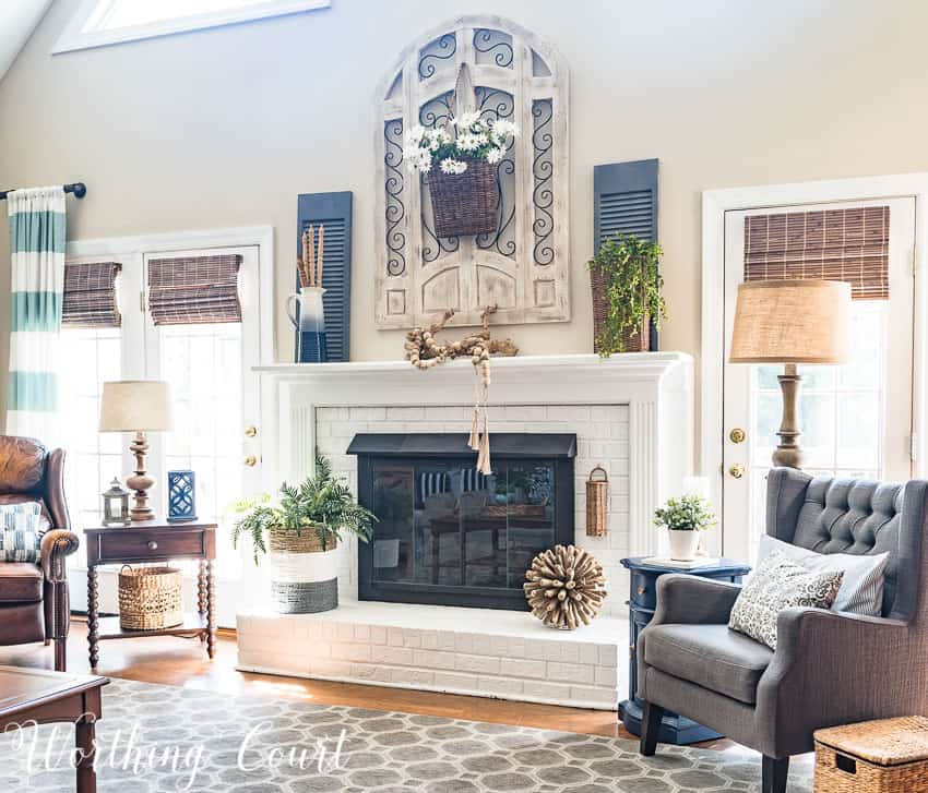 Painted brick fireplace decorated with natural and organic elements for summer || Worthing Court