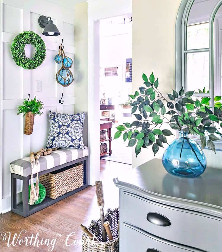 Farmhouse style board and batten foyer wall decorated for summer with turquoise and green || Worthing Court