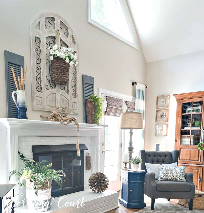 Fireplace decorated with simple organic elements for summer || Worthing Court