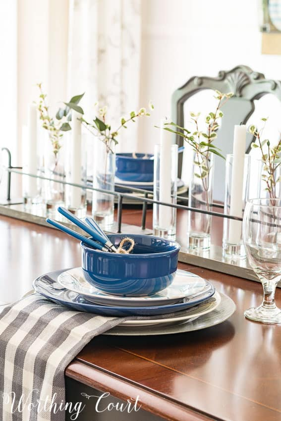 Summer place setting with blue, white and gray dishes