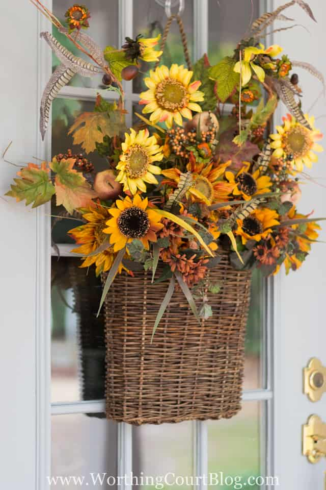 Fill a hanging basket with artificial foliage for an easy fall wreath for your door. || Worthing Court
