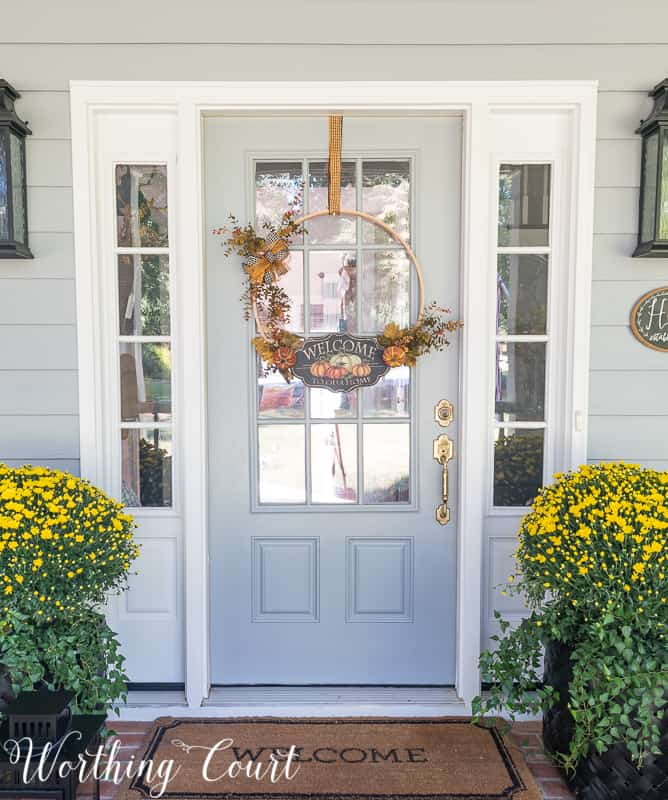 Easy diy fall embroidery hoop wreath hanging on the front door.