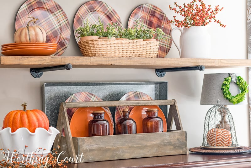 Fall shelf decorating ideas with plaid plates, brown glass bottles, pumpkins and a toolbox || Worthing Court #fall #autumn #falldecor