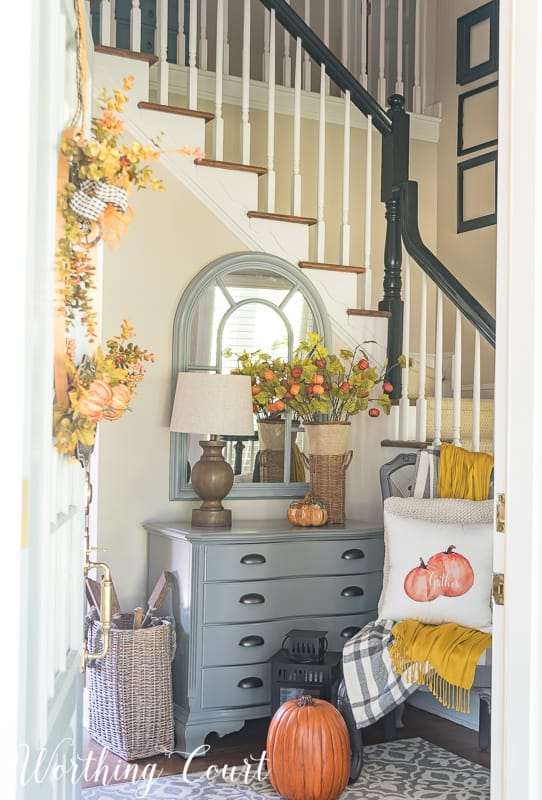 Fall foyer decor with traditional autumn colors.