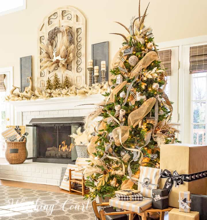 Christmas tree and fireplace decorated with neutral colors