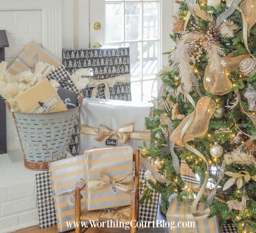 Coordinating Rustic Glam Christmas Wrap plus there is a vintage rustic bucket filled with gifts by the fireplace.