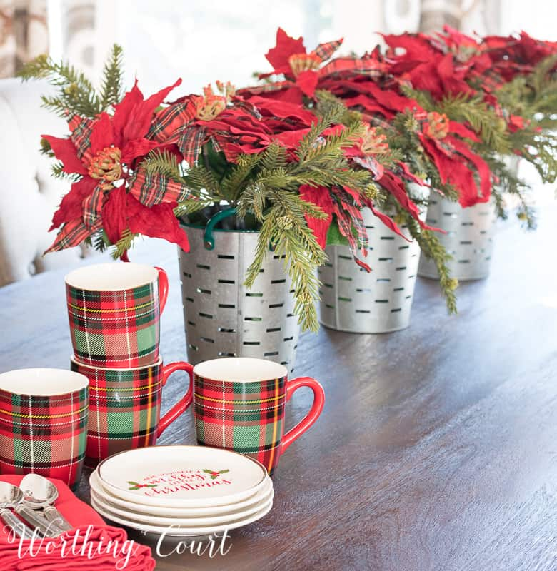 Simple Christmas centerpiece with faux poinsettias in galvanized buckets #christmas #christmascenterpiece #poinsettias #plaid